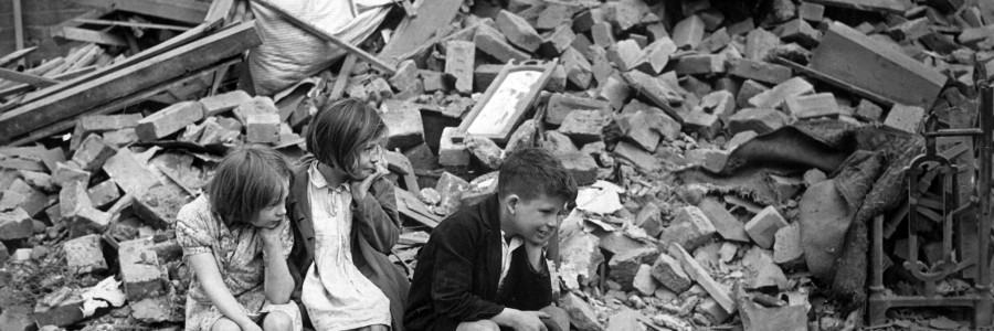 Children of an eastern suburb of London, who have been made homeless by the random bombs of the Nazi night raiders, waiting outside the wreckage of what was their home.  September 1940.   New Times Paris Bureau Collection.  (USIA) Exact Date Shot Unknown NARA FILE #:  306-NT-3163V WAR & CONFLICT BOOK #:  1009