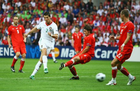 GENEVA - JUNE 11: Cristiano Ronaldo of Portugal scores his team's second goal during the UEFA EURO 2008 Group A match between Czech Republic and Portugal at Stade de Geneve on June 11, 2008 in Geneva, Switzerland. (Photo by Bryn Lennon/Getty Images)