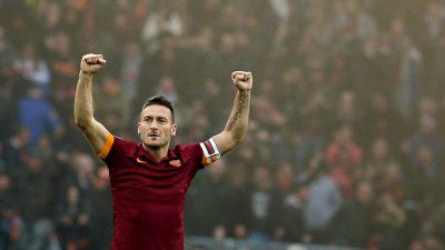 Roma's forward Francesco Totti celebrates after scoring during the Italian Serie A football match AS Roma vs Lazio on January 11, 2015 at the Olympic Stadium in Rome. AFP PHOTO / TIZIANA FABI (Photo credit should read TIZIANA FABI/AFP/Getty Images)